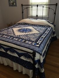 Quilt not for sale.  Queen size iron bed by Brass Beds of Virginia.