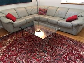 3 piece leather sectional sofa and glass top table. Rug not for sale