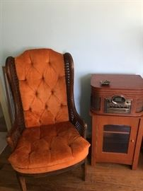 Combo record player on glass door cabinet and a chair to listen with !