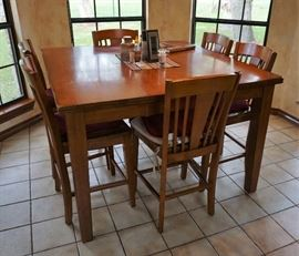 Bar height dining table and 8 chairs