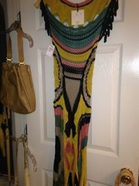 Interesting knitted dress with tag