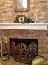 Brass fireplace tools, fire screen, and log holder; mantle clock