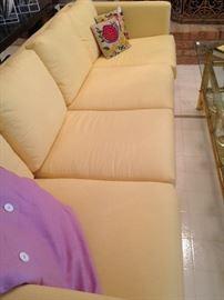 1 of 2  sleek 4-cushion yellow sofas