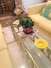 Narrow and long brass and glass top coffee table