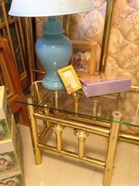 Brass and glass nightstand; blue ginger jar shaped lamp