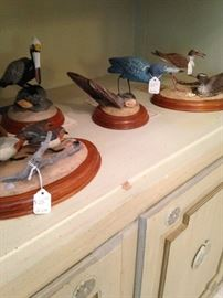 More bird figurines with wooden bases
