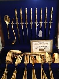 Community gold toned stainless flatware set