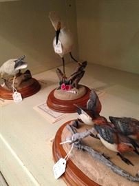 Bird figurines with wooden bases