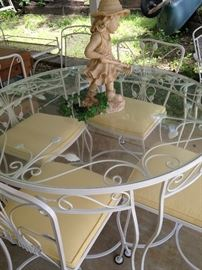 White round patio table with 4 chairs/yellow cushions
