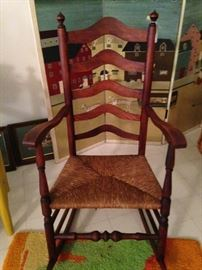 Wooden rocker with rush seat
