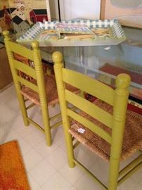 Avocado ladder back chairs at another glass top table