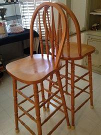 Two light wood bar stools