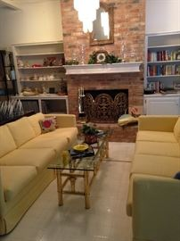 Long, sleek 4-cushion yellow sofas give a great pop of color!