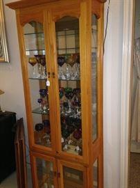 Slender curio cabinet
