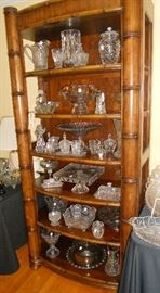 Six shelf wooden etagere with array of crystal items