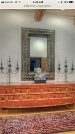 Absolutely stunning sideboard large silver mirror and candelabras and runner all for sale. Bust is not for sale sorry.