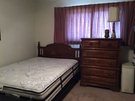 Queen size bed. Mattress appears to be brand new