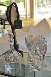Gorgeous cut crystal champagne glasses and a lovely ships decanter