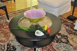 "Black woodenand glass 38"" roundcoffee table with lower shelf, 17""h."
