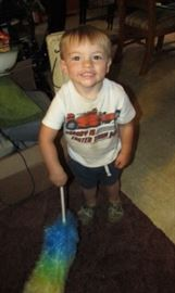 My grandson all smiles and loving helping get things ready!
