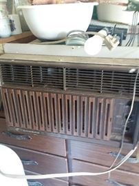 Old air conditioner, don't know if it works or maybe could be salvaged.