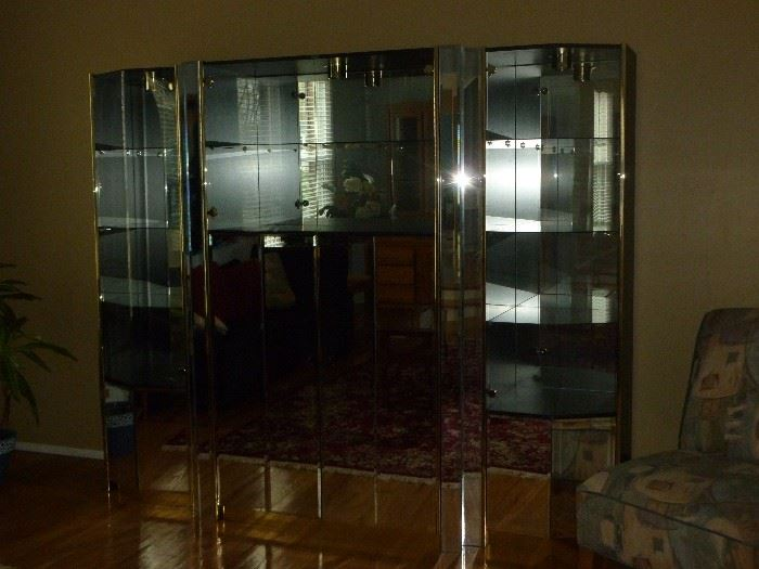 Mirrored 3-piece wall unit..center is entertainment center, end pieces separate and can be corner curios or together as one