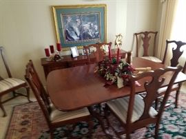 Formal dining w/ side board, 6 chairs, 3 leaves.