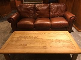 BROWN LEATHER COUCH , WOOD COFFEE TABLE