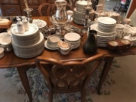 """White Furniture Company """"Lorraine"""" dining room table with leaves...loaded with china and silverplate."""