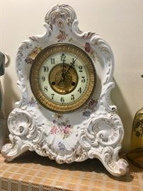 Antique clock with porcelain case
