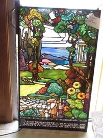 large Stained glass window, bottom has poem by William Morris