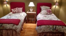 Pair of twin beds-upholstered headboards and metal frames w/mattresses and boxsprings.  Linens sold separately