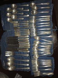 Sterling flatware set.