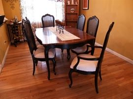Antique mahogany dining room set includes 6 chairs and 2 leaves.  Newly upholstered.  Asking $1500