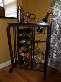 Wrought iron wine rack with ice bucket and glass holder.  Asking $50