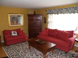 Living room set with sofa and snuggler, coffee table and end table.   Make an offer.
