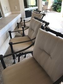 4 Absolutely beautiful solid wrought iron (NOT cast aluminum) high-end barstools with cushions.   These chairs have been placed underneath their patio and were never in direct sunlight.