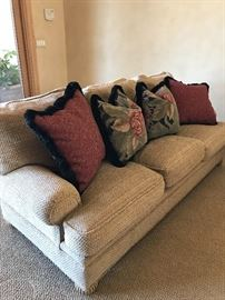 Custom-made extremely comfortable courch/Sofa with custom-made pillows.  Hardly used and in excellent condition!  Main upholstery  is a nubby creamy/tan silk chenille fabric.  Lined wood bunn feet.