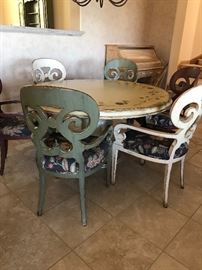 French Country Solid Round Wood Table with 6 Barrel Back Chairs. The top of the table has been hand-painted with flowers along the edge