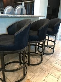 Stunning Bar Stools in ultra suede and heavy wrought iron. These are in excellent condition!