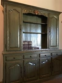 Gorgeous French Display Hutch Cabinet in a Darker Sage Green.  This is made of very beautiful wood. It's all solid wood. Absolutely no partical board!  This could easily be transformed into another color.