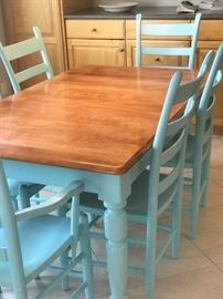 Dining room Farmhouse Leg Table, (2 leaf, 4 Ladderback Chairs, 2 Ladderback Side Chairs. Comfortably seats up to six. Remove 2 leaf and 2 chairs and enjoy a more compact table that sits four.