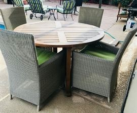 Teakwood Dining Table with 4 Captiva Seaside Arm Chairs. (indoor/outdoor light grey resin wicker) perfect for patio dining/partying by the pool!