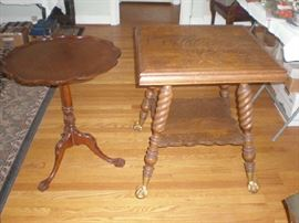 Round pie crust edge table and turned leg parlor table with glass ball and claw feet.