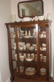 Beveled mirror, creamy white pottery, mission china cabinet, large set of Franciscan Apple dishes and accessories.