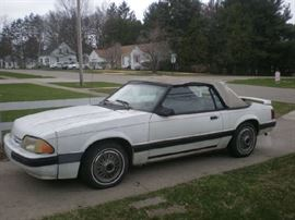 1988 Ford Mustang Convertible, white, red interior, 183,835 miles, runs good, needs new top.