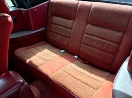 Mustang back seat, red interior.