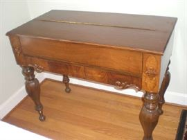 The spinet desk closed up, notice the beautiful legs and detail and trim in the wood.