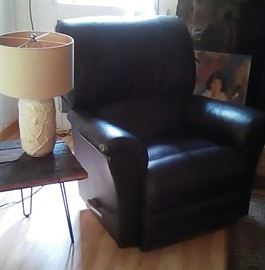 Dark brown leather Lazy Boy recliner, handmade Arkansas table on hair pin legs, lamp
