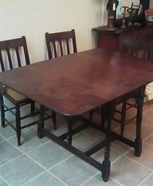 Gate leg table with 4 cane bottom chairs